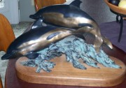 """Ultimate Swimmers"" bronze sculpture by Ann LaRose"