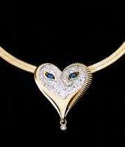 """Sapphire Eyes & Diamonds Mask"" 18K Gold with diamonds and Sapphires Pendant by Erte"